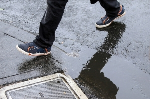 Residents and visitors alike walk the streets of San Francisco with umbrellas and plastic ponchos as raindrops fell from the skies Wednesday, September 30, 2015. The precipitation is a welcomed sight with California facing one of the most severe droughts on record. (Mike Koozmin/S.F. Examiner)